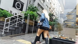 Blonde in Ultra Mini Skirt Wears Sexy Black Boots